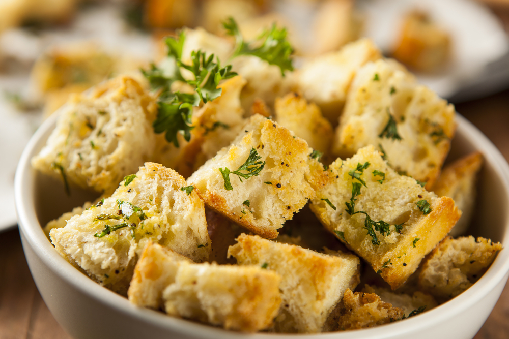 Bowl of croutons with herbs