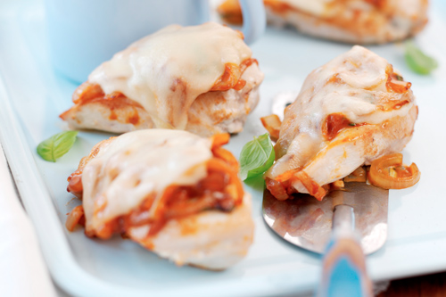 Breast of Chicken with Tomatoes, Onions and Basil, Topped with Melting Cheese